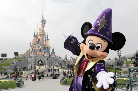 (FILES) - A file photo taken on March 31, 2012 shows Disney character Mickey posing in front of the Sleeping Beauty Castle at Disneyland park as part of the 20th birthday celebrations of the park, in Chessy, near Marne-la-Vallee, outside Paris. Euro Disney, which runs Disneyland Paris, a top European tourist attraction, announced on October 6, 2014 it was receiving a one-billion-euro refinancing package to overcome a crisis after a sharp fall in visitor numbers and spending. Shares in the company plunged by nearly 12.0 percent in initial trading in Paris. The plan includes a cash infusion of 420 million euros ($526 million) by the parent company, US-based Walt Disney Co, and a conversion of 600 million euros of debt owed to Walt Disney into equity, the company said in a statement. AFP PHOTO / THOMAS SAMSONTHOMAS SAMSON/AFP/Getty Images ** OUTS - ELSENT, FPG - OUTS * NM, PH, VA if sourced by CT, LA or MoD **
